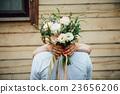 Beautiful wedding bouquet in hands of the bride 23656206