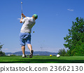 Golfer playing on golf course 23662130