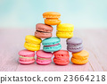 colorful macarons on a pink wooden table 23664218