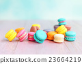 colorful macarons on a pink wooden table 23664219