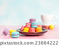 French macarons on pink wooden background.  23664222