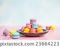 French macarons on pink wooden background.  23664223