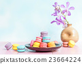 French macarons on pink wooden background.  23664224