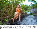 Photo young girl enjoying tropical fruits in 23669191