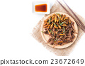 fried grasshoppers and Silkworm pupa 23672649