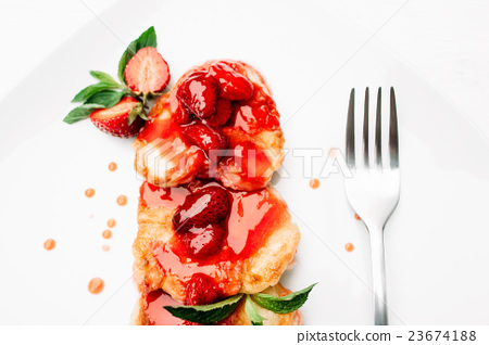 Served with fork dessert of pancake and strawberry 23674188