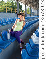 Sporty girl on the stadium 23678923