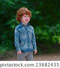 cute little emotional boy outdoors 23682435