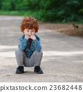 cute little emotional boy outdoors 23682448