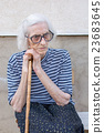 Senior women supporting on a walking cane 23683645