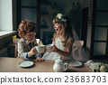 boy and girl having tea party in cafe 23683703