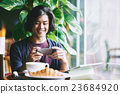 Photographing breakfast 23684920