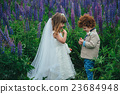 two funny little bride and groom 23684948