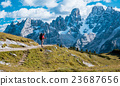 hiker with backpack standing on path in mountains 23687656