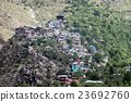 A small town village at top of hill.  23692760