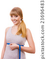 woman measuring her size under breast isolated 23696483