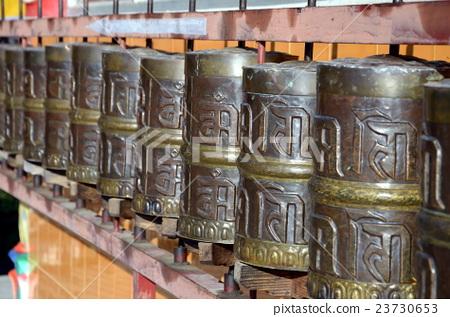 A row of Tibetan prayer wheels (selective focus) 23730653