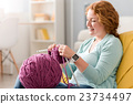 Pleasant delighted senior woman knitting 23734497