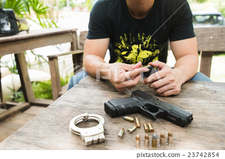 man input bullets gun 23742854