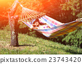 Woman on hammock in spring 23743420