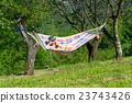 Woman sitting on hammock 23743426