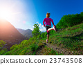 Jogging through the countryside on the mountain path Girl 23743508