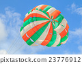 Parasailing, beach umbrella on sky background 23776912