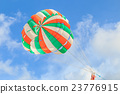 Parasailing, beach umbrella on sky background 23776915