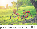 Red Japan style classic bicycle at the park 23777043