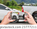 Hand of woman holding smartphone and take photo of car accident 23777211
