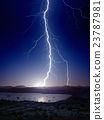 Powerful lightning near small city 23787981