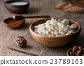 Cottage cheese in a wooden bowl  23789163