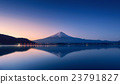mount Fuji at dawn with peaceful lake reflection 23791827