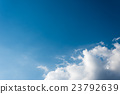 Beautiful blue sky with volumetric clouds 23792639