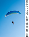 Paragliding in the sky 23792696