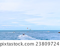 Para-sailing extreme sport player in the sea. 23809724