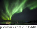 Strong green aurora northern lights over mountain 23815684
