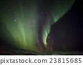 Strong green aurora northern lights over mountain 23815685