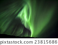 Strong green aurora northern lights over mountain 23815686