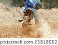 motocross racer accelerating speed in track 23818902