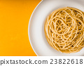 Spaghetti  on the plate on the background top view 23822618