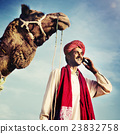 Indian Man On the Phone Camel Communication Concept 23832758