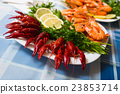 Delicious Mediterranean seafood shrimps and crawfish close up 23853714