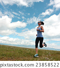 young fitness woman runner running on grassland 23858522