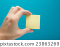 Sticky note, finger up of thumb, yellow reminder 23863269