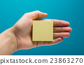 Sticky note, finger up of thumb, yellow reminder 23863270