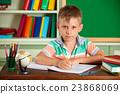 Schoolboy in classroom. 23868069