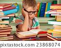 Schoolboy in classroom. 23868074