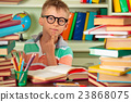 Boy studying in the library. 23868075