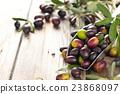 Fresh olives in scoop. 23868097